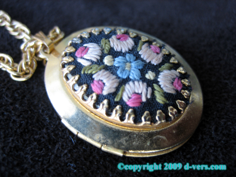Gold plated embroidered locket with floral design