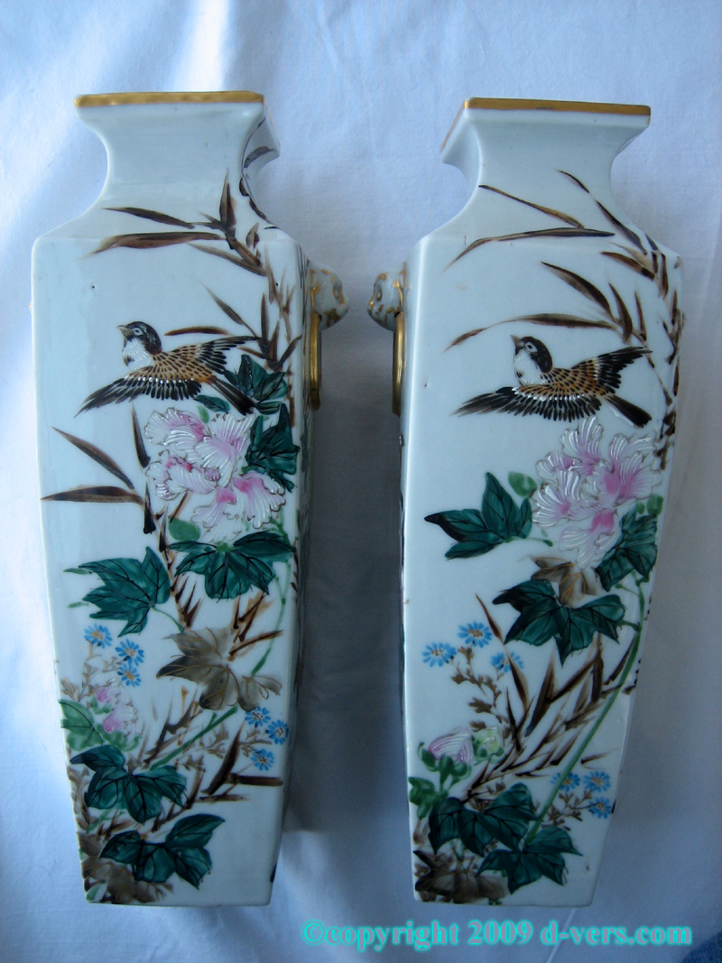 Pair of Japanese porcelain vases with bird and flower design