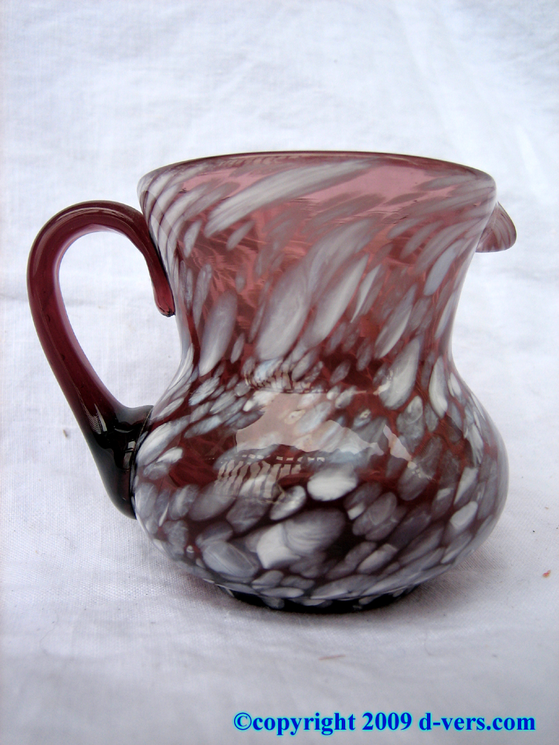 Antique end of day hand blown mini pitcher