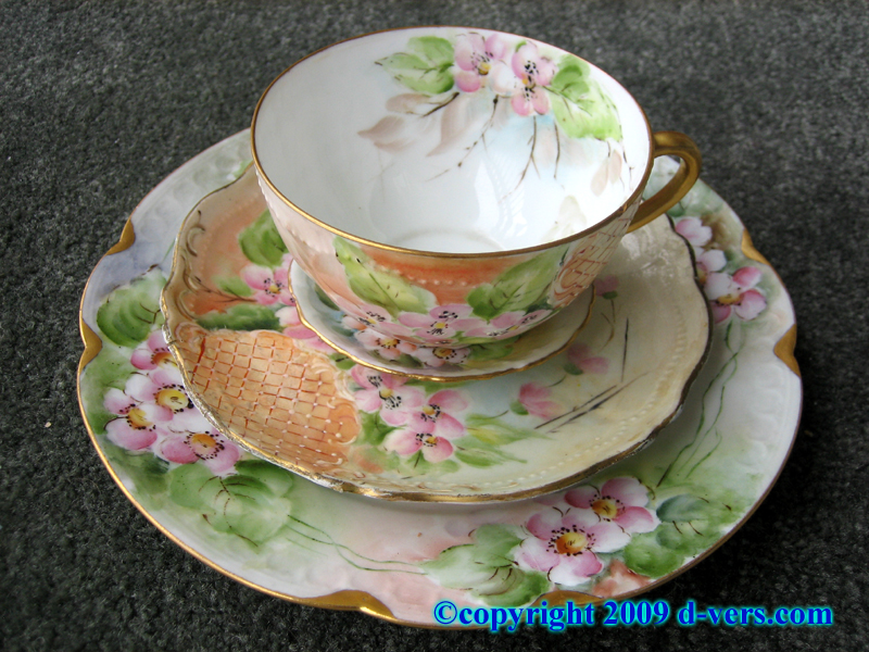 Hand painted cup and saucer set with cup plate