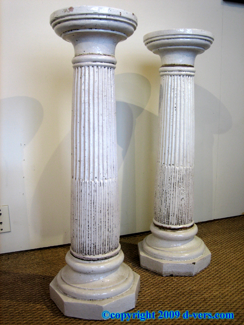 Classical column stands made of white ceramic