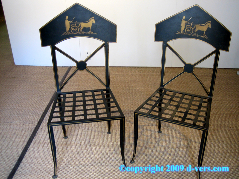 Neo-Classical style metal chairs in black with gilded decoration