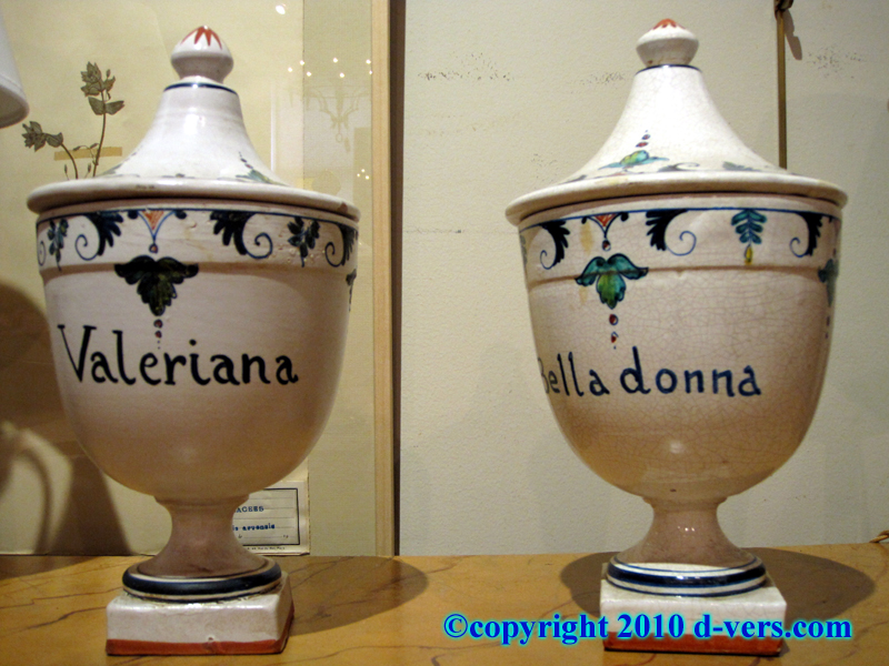 Urn shaped covered apothecary jars with painted herb names