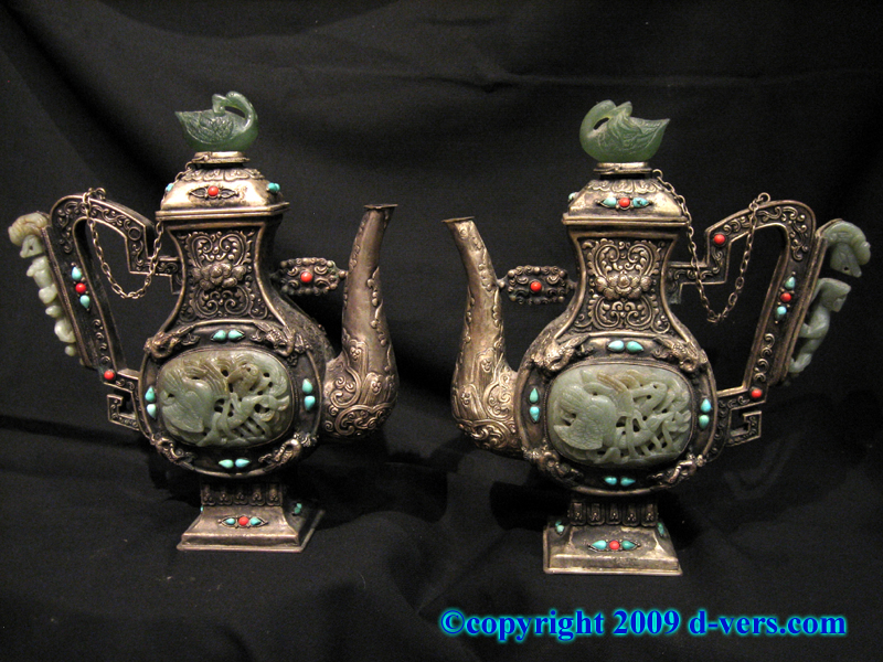 Chinese pair of Silver overlaid on pewter wine pots with Mongolian design