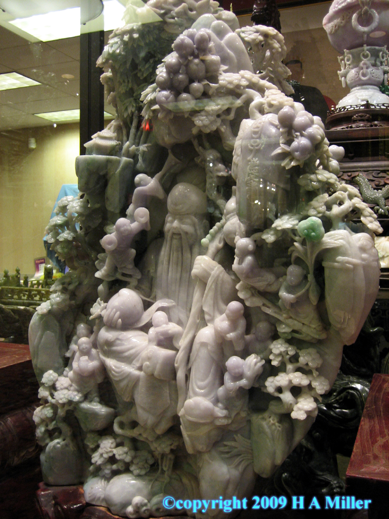 Chinese carved jadeite boulder sculpture of Longevity