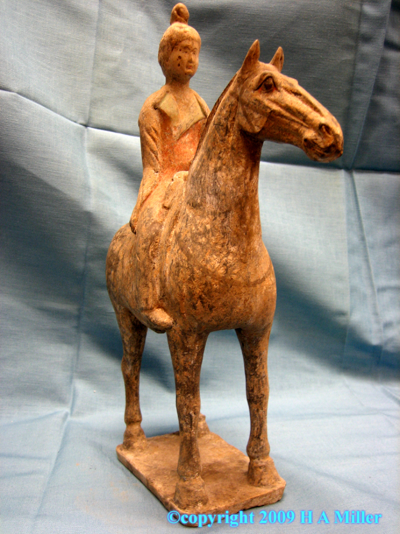 Chinese painted pottery figure with equestrian from the Tang Dynasty
